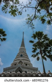 White Pagoda amidst a tree garden.