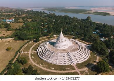 The white pagoda of Hsinbyume is located near Mingun Pagoda,near Mandalay, Myanmar. Beautiful white Hsinbyume Pagoda in Mingun seen from above, aerial hoto
