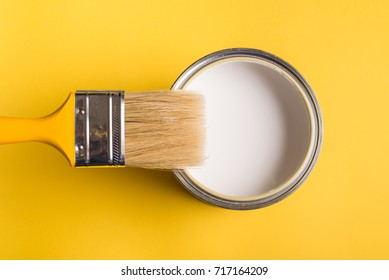 White Paint Can with Brush Top View On Yellow Background. - Shutterstock ID 717164209