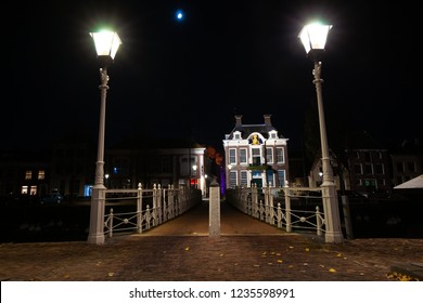 White painted bridge with classic details and traditional street lanterns. Smits work from the time of the industrial revolution with authentic details.