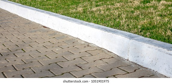 White painted curb in the park