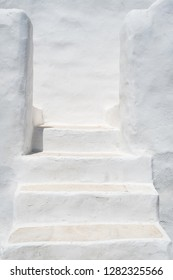 White painted stairs in a traditional Cycladic architecture style,  Paros island, Cyclades, Greece. Abstract architecture backround