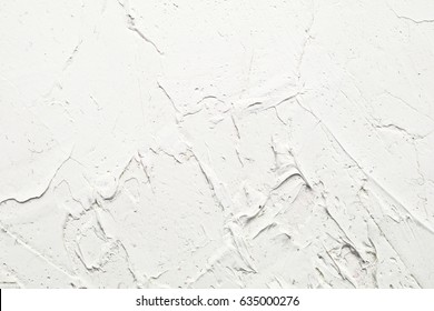 White painted texture with brush and palette knife strokes for interesting and modern backgrounds. Suitable for web designs and wallpapers.