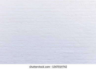 white painted vintage old brick wall gives a harmonic background