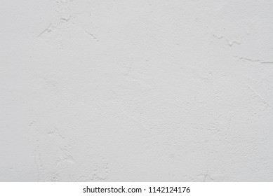 white painted wall texture background closeup
