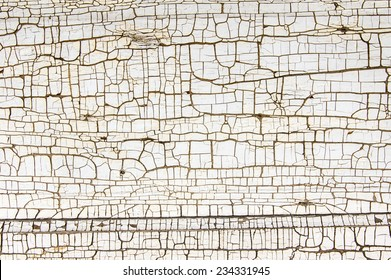 White painted wooden board showing crackled paint
