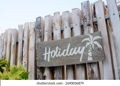 White painting on wooden board ' Holiday' with coconut tree