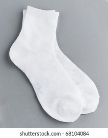 a white pair of sock isolated on white grey background