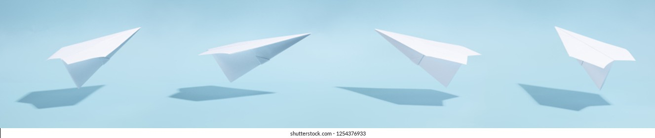 white paper airplane on a blue background