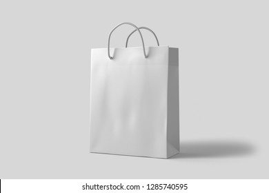 White paper bag mock up with handles on gray background. High resolution.