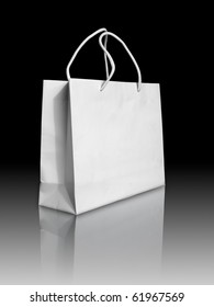 White paper bag on reflect floor and black background