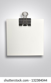 White paper with binder clip (clipping path)