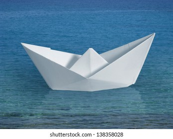 white paper boat in blue oceanic ambiance