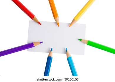 White paper card and seven color pencils of rainbow colors (isolated on white)