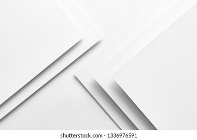 White paper concept background with shadow and copy space. White geometric layer design with sheets of paper. Flat lay