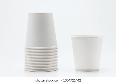White paper cup and cups on white backbround