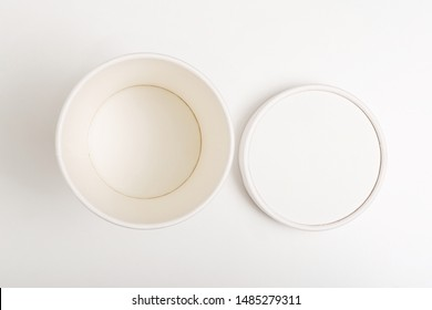White paper cup with lid on white background. Empty paper cup with lid mockup on white background. Flat lay. Top view