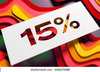 White Paper Cut 15% Symbol on the Green and Yellow Layered Cardboard Background. 3D Illustration of White 15% Symbol Sale, Fifteen-Percent Off Symbol for Newsmakers.