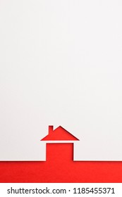 white paper cutout in basic house shape with border background by red paper, for home and insurance conceptual.