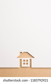 white paper cutout in complete house shape with border background by brown paper, for home and insurance conceptual.