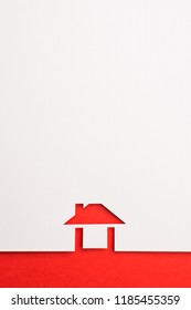 white paper cutout in easy house shape with border background by red paper, for home and insurance conceptual.