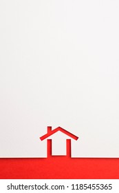 white paper cutout in minimal house shape with border background by red paper, for home and insurance conceptual.