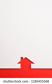 white paper cutout in simple house shape with border background by red paper, for home and insurance conceptual.