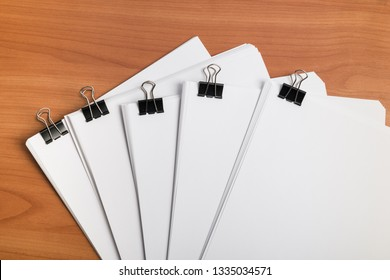 White paper document template with metal clips binder on work table top view