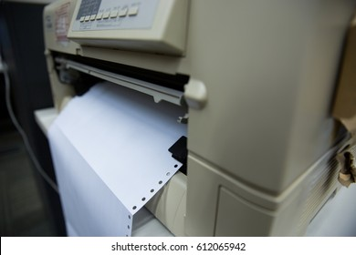 White paper in dot matrix printer.