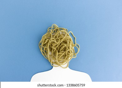White paper head with messy and chaotic bunch of wool instead of mind