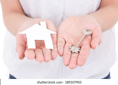 white paper house and metal key in female hands