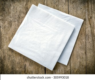 white paper napkins on old wooden table