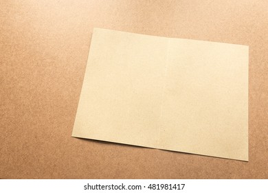 White paper note on business wood desk with copy space.