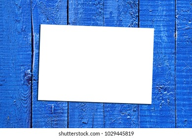 White paper on the old blue wooden surface