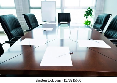 White paper with pen in the meeting room.