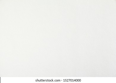 White paper with rough surface texture background. Looks like white plastered wall.