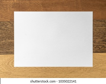 White paper sheet on wood pattern and texture for background.