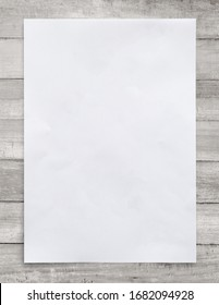 White paper sheet on wood for business background. Close up image.