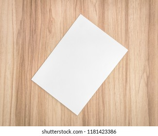 White Paper Sheet On Wooden Background Template Of A4 Document And Blank Space For Text