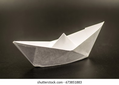 white paper ship on the black background