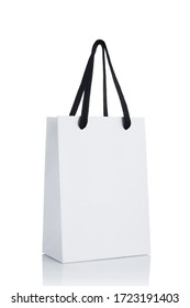 white paper shopping bag isolated on white background. Mockup for design. sale concept.