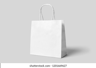 White paper shopping bag Mock-up on soft gray background.Сan be used for design and branding