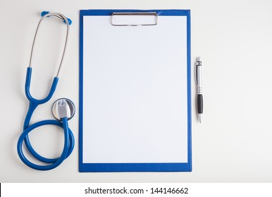 White paper, stethoscope and a pen