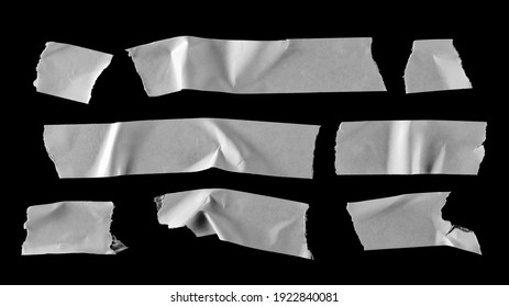 White paper tape pieces set and collection isolated on black background with clipping path, top view