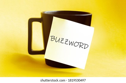 white paper with text BUZZWORD on the black cup