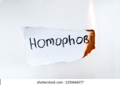 White paper with text homophobia burns. concept there is no homophobia