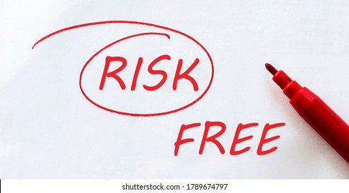 white paper with text Risk Free on the white with red marker
