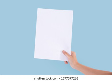 white paper in woman hand on blue sky
