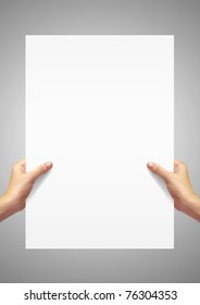 White paper in woman hand on gray background.