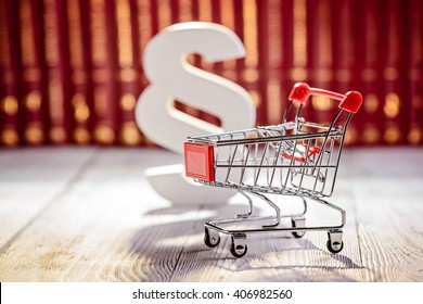 White paragraph the symbol of law and small trolley the symbol of commerce. Commerce law concept